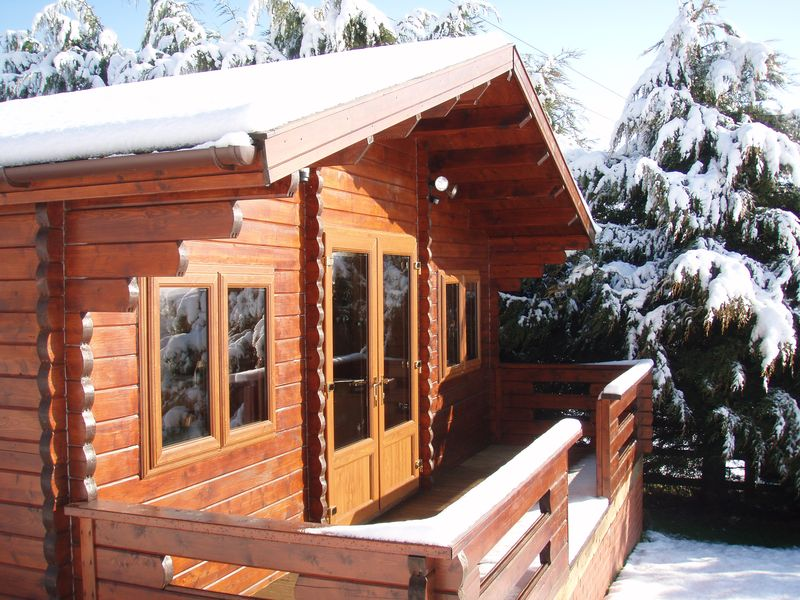 Our cosy Keops log cabin office in the snow