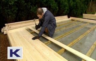 Lay the floor boards across the pressure treated floor bearers