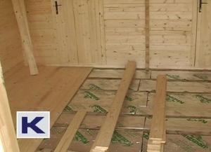 Floor insulation shown underneath the floorboards