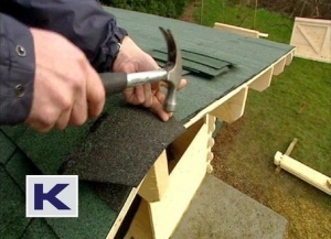 Bend the shingle over the ridge and nail down firmly
