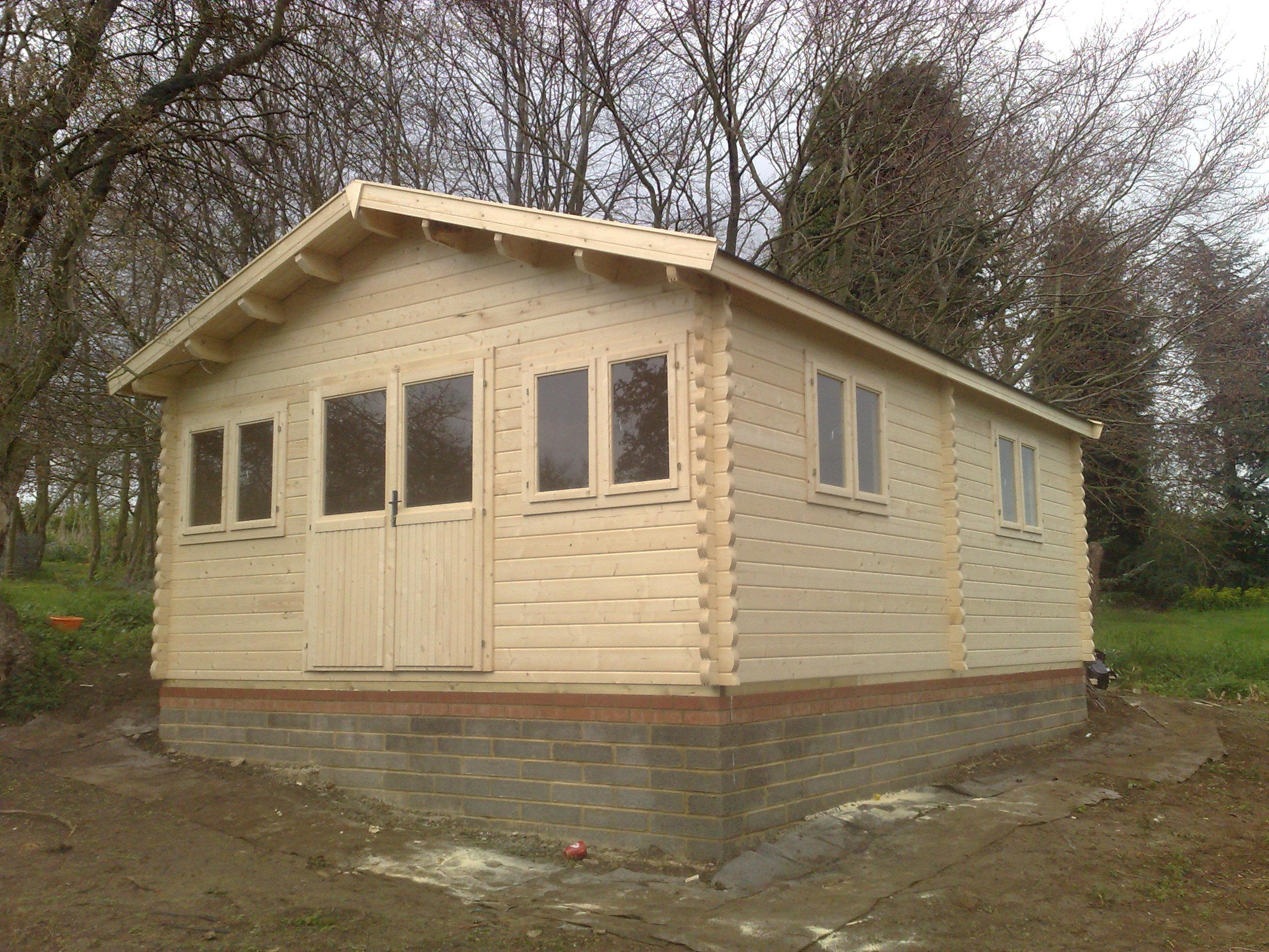 Brick base keops interlock log cabins for Brick cabin
