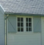Log cabin shutters for security