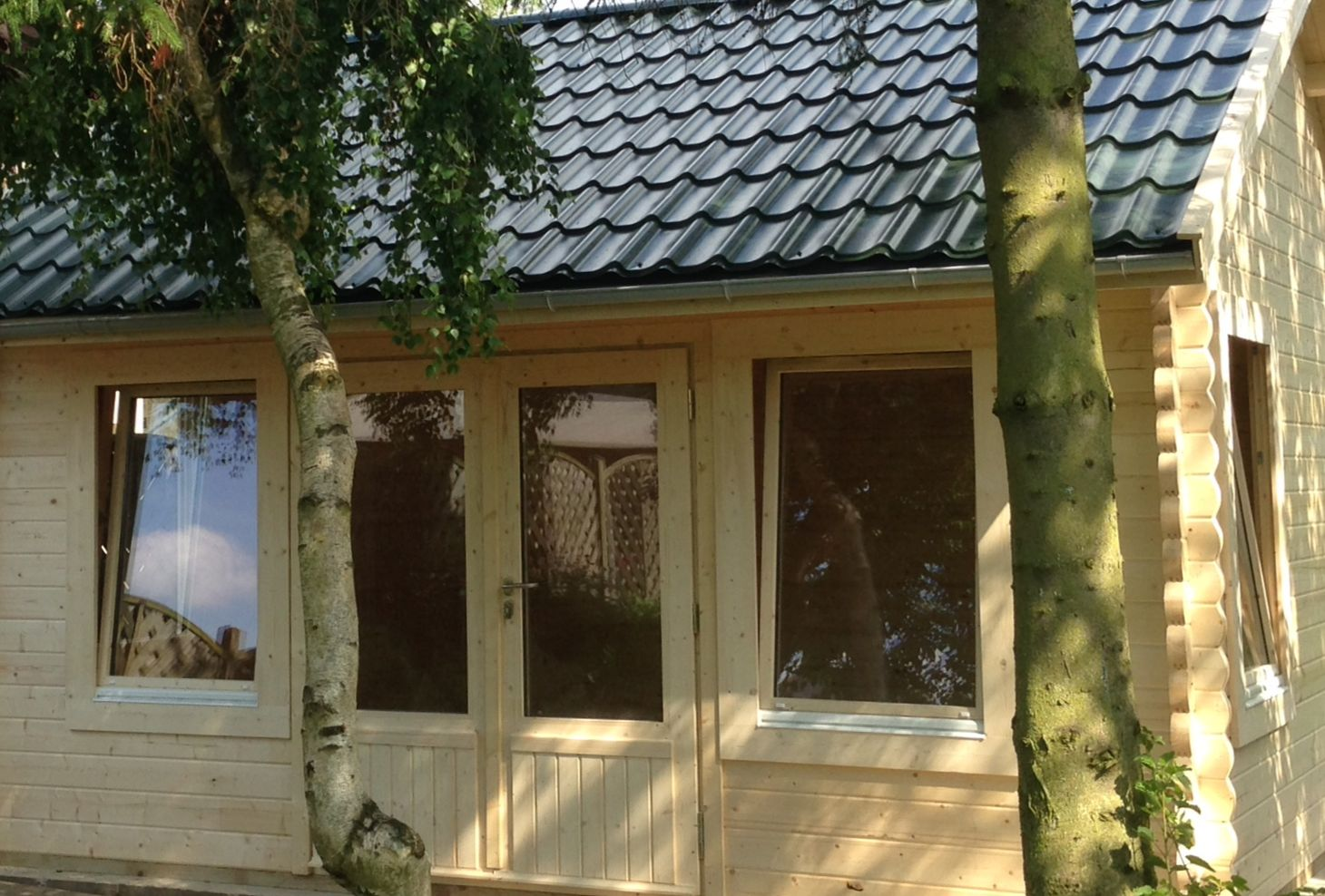Doors windows keops interlock log cabins for Windows for log cabins