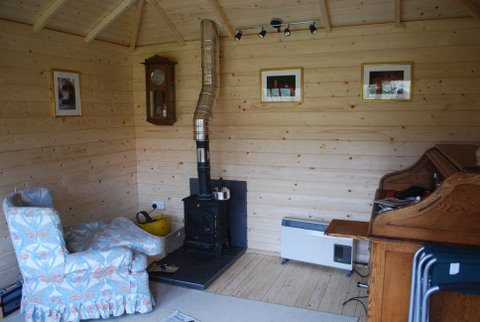 Lugarde log cabin with wood burning stove