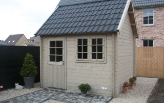 cottage with black pantile roof