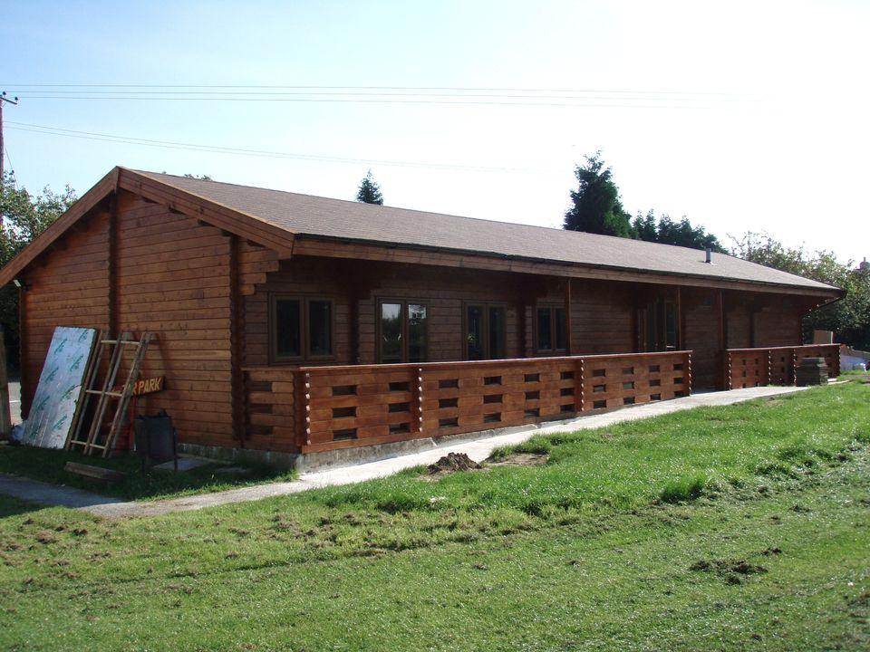 This sports pavilion features a wide veranda
