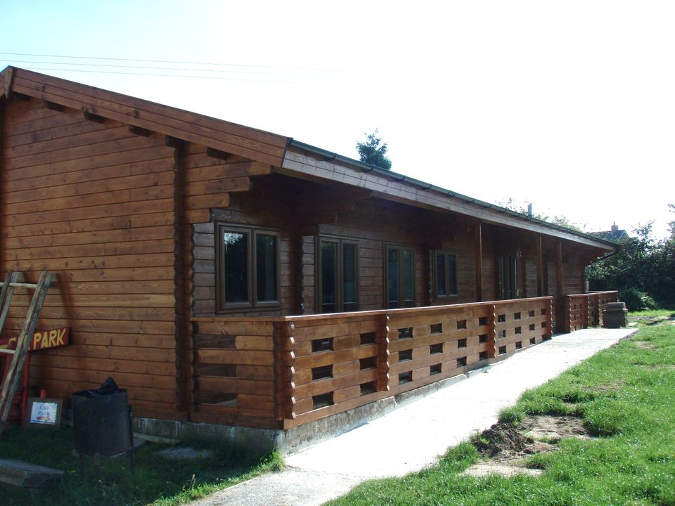 Log cabin sports pavilion and changing rooms