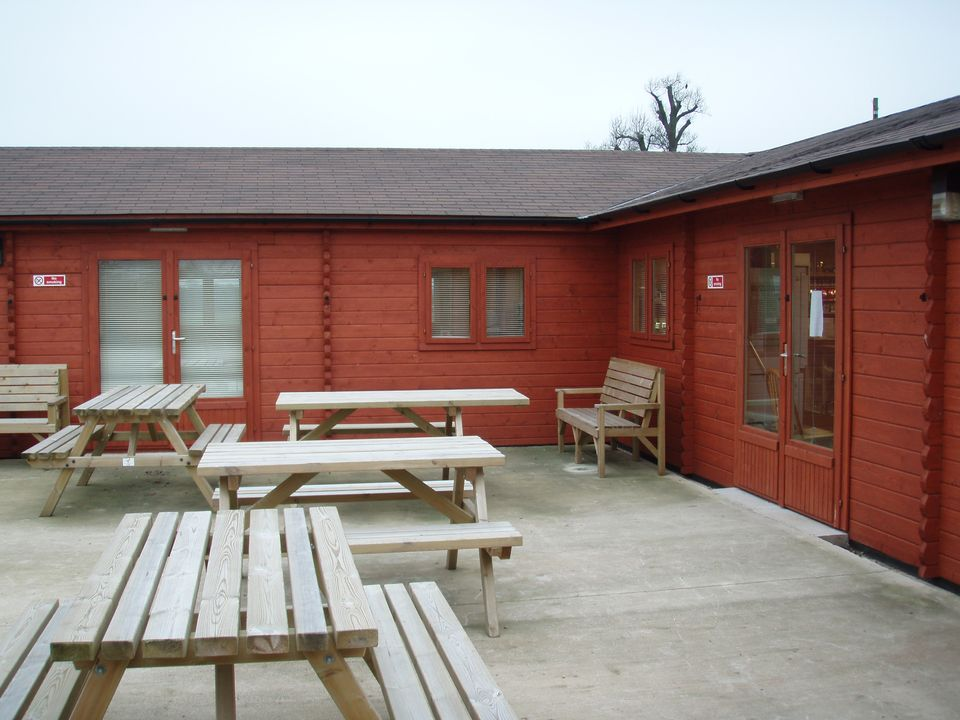 Log cabin cafe and visitor centre with outside seating