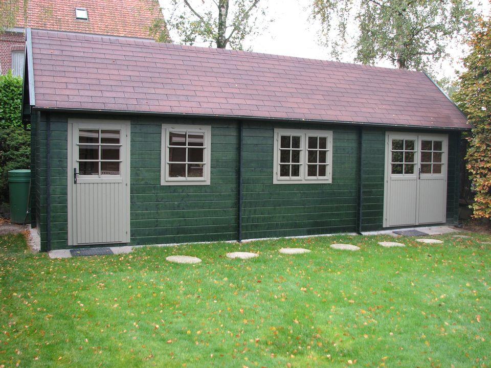 Donovan Keops Cottage steep roof log cabin