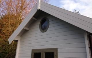 Keops Interlock oval log cabin window