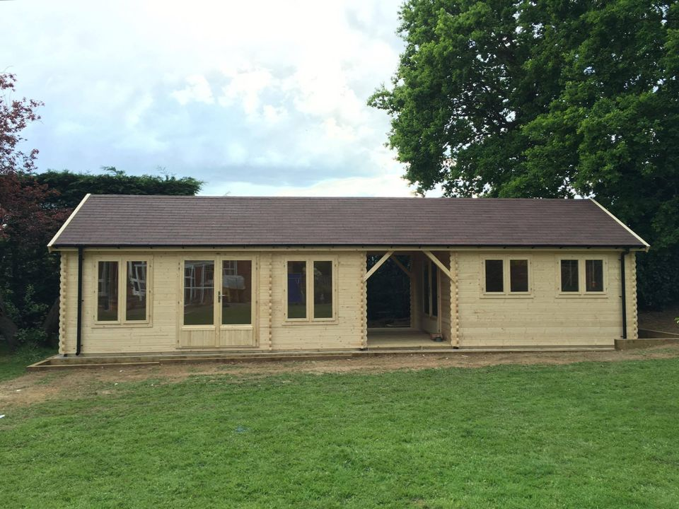 Two Keops log cabins with 1 metre canopies