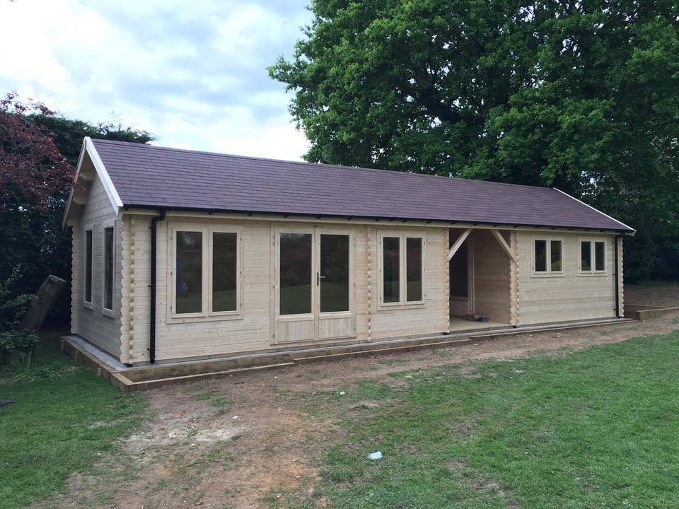 Sarah max 39 s log cabin build video keops interlock log for 2 bedroom cabins to build