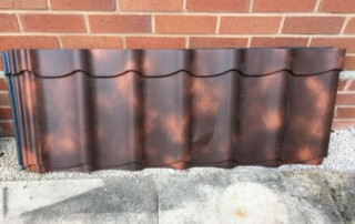 Cloudy terracotta metal pantile roofing