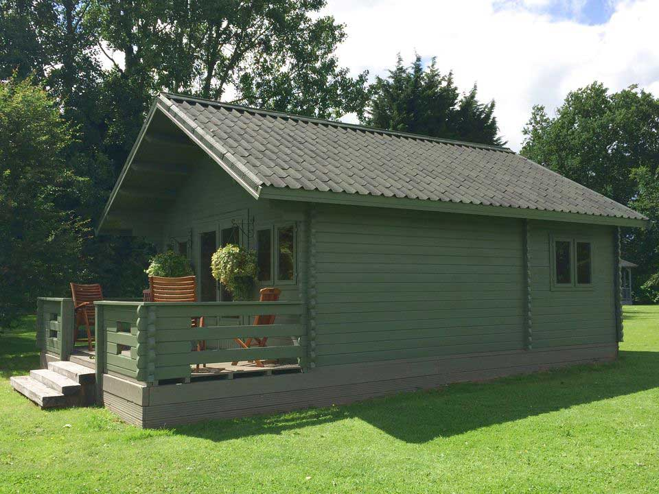 Forest Lodge with villa roofing in shaded green