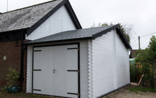 Keops eaves front Classic log cabin garage