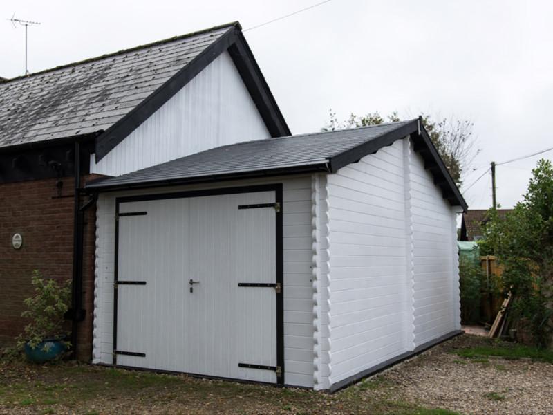 Keops eaves front Classic log cabin garage
