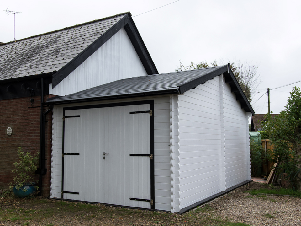 Jims eaves front Classic style garage Keops Interlock Log Cabins