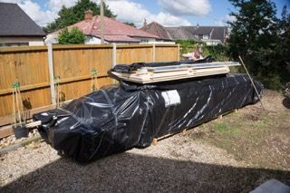 Delivered! The log cabin garage pallet - wrapped and banded