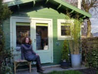 Lucy outside print studio log cabin