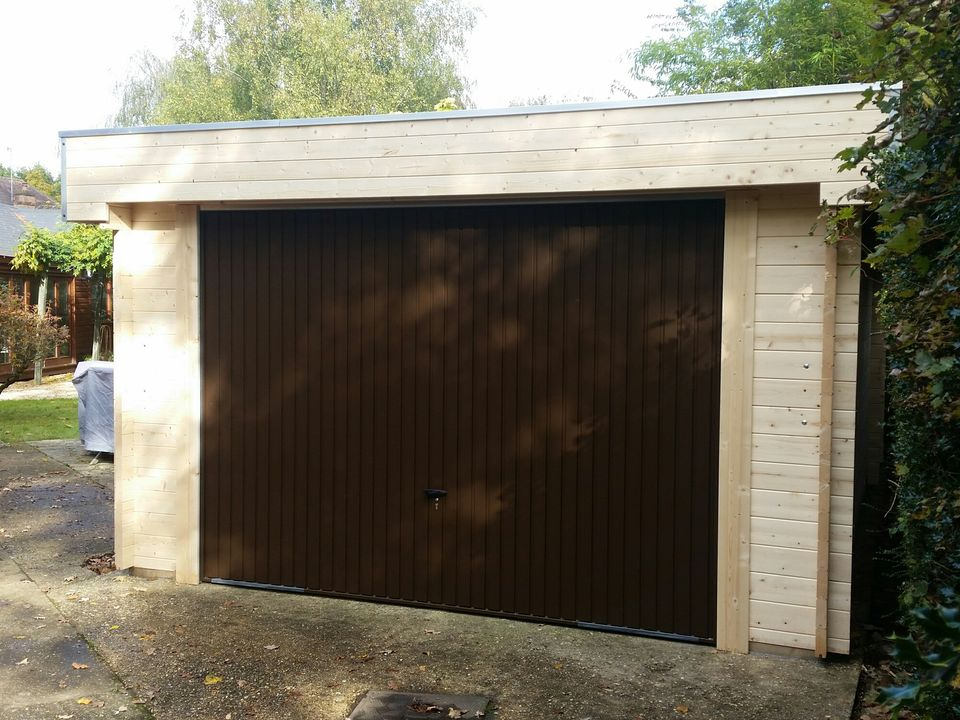 Keops Moderna flat roof garage with up & over door