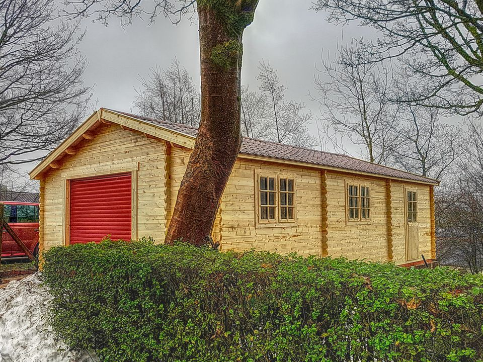 Keops Classic garage with automated door in Ruby Red