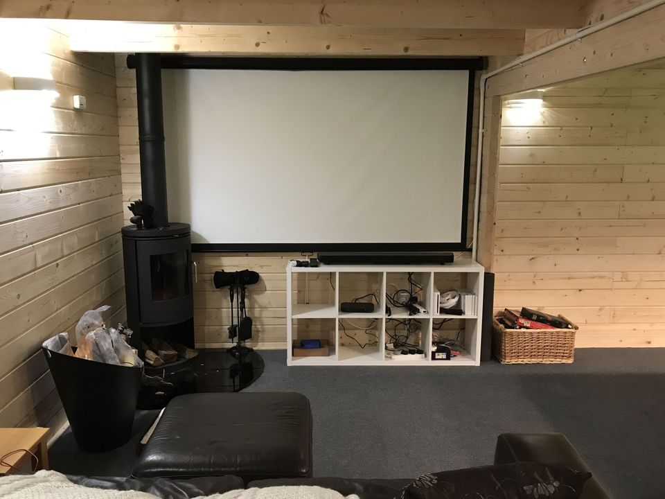 Man cave with wood burner for cosy cinema nights