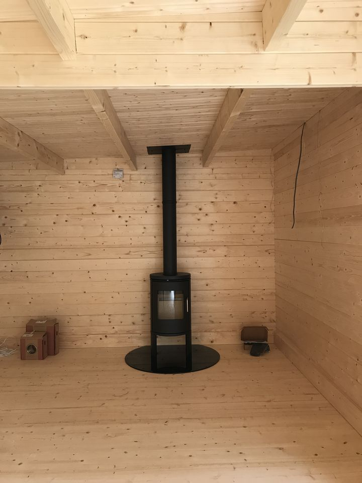 Morso stove and flue for Keops Moderna flat roof log cabin