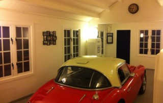 Log cabin garage for classic car