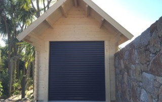 Automated roller garage door for log cabins
