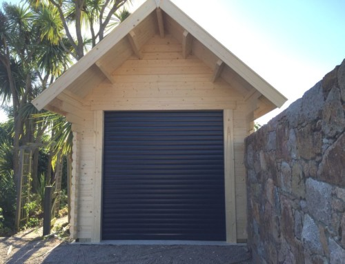 Automated roller doors for log cabin garages