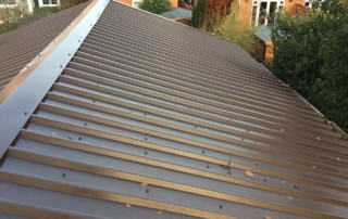Low maintenance metal box profile roofing
