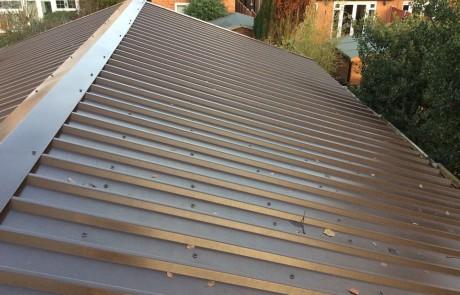 Low maintenance metal box profile roofing