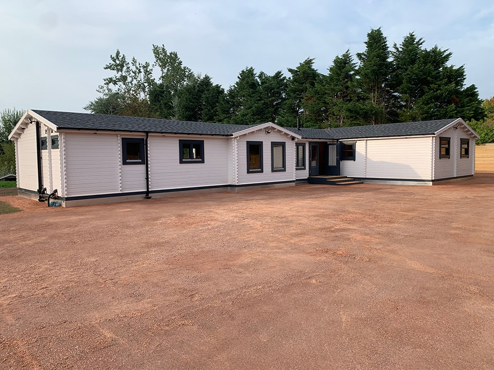 Keops Interlock - our new log cabin offices